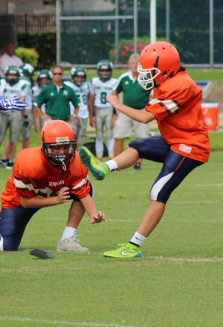 Emma Shirzad, with Will Mahon as the holder, attempts an extra point against Pine Crest Fort Lauderdale on September 6.