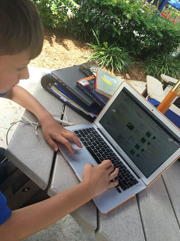 Seventh grader Matthew Postman checks his grades via onCampus during lunch.