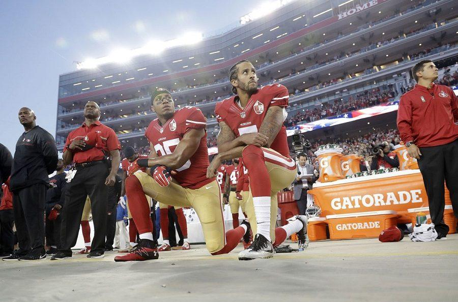 Colin+Kaepernick+%28right%29+and+teammate+Eric+Reid+kneel+during+the+San+Francisco+49ers%27+home+opener+against+the+Los+Angeles+Rams+on+September+12%2C+2016.