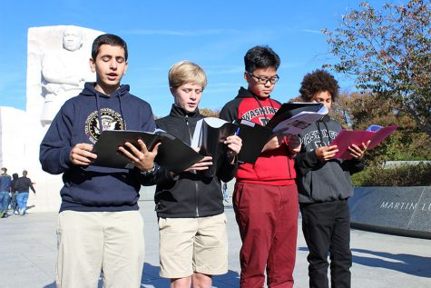 "Left to right: Eighth graders Alex Michelon, Carter Stewart, Steven Gu, and Garison Gelman read their poem based on MLK, Jr.'s ""I Have a Dream"" speech in front ofthe civil rights leader's memorial."