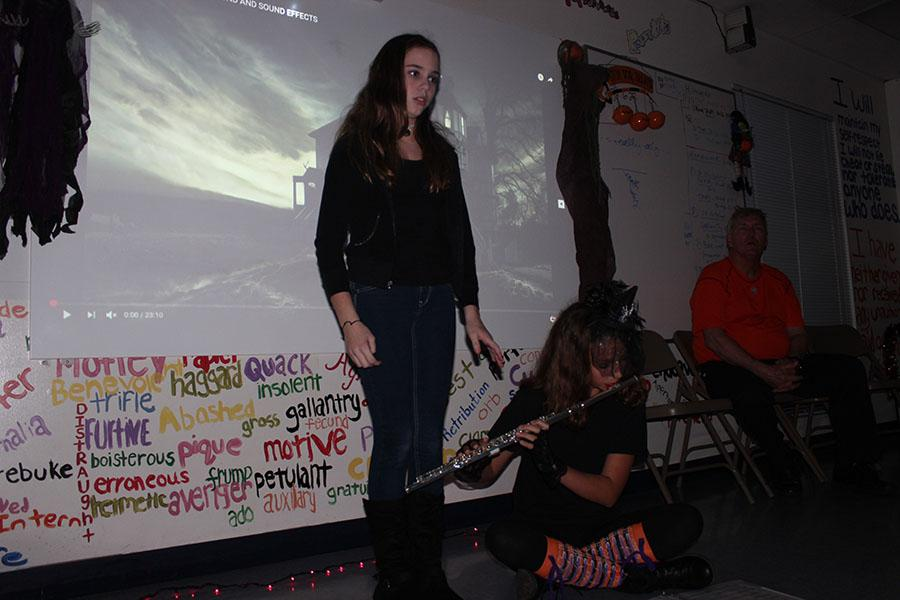 Seventh grader Catherine Schenk reads a poem to eerie music via the flute played by fellow seventh grader Ella Pierman.