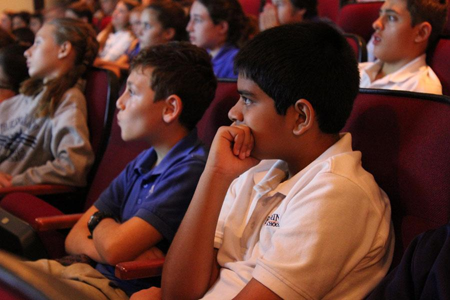 Sixth graders Aadi Patel (right) and Brandon Baklayan watch Screenagers with the rest of the middle school in the BPAC.