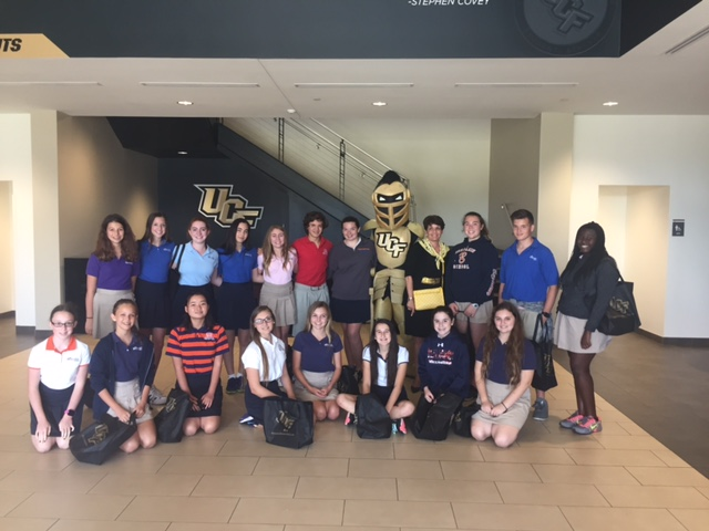 Mrs.+Corey+and+Benjamin%27s+middle+school+student+council+members+pose+with+Knightro%2C+UCF%27s+mascot.