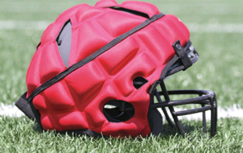 The Guardian Cap, which comes in a variety of colors, has caught on in many schools during practices, but not in games.