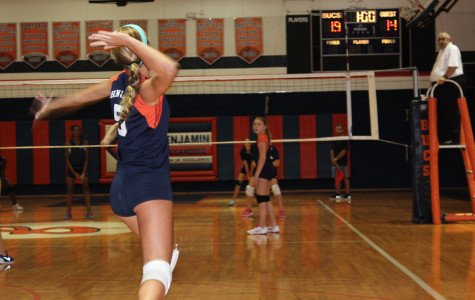 Eighth grader Chloe Jezerinac prepares to blast a serve during the team's game against