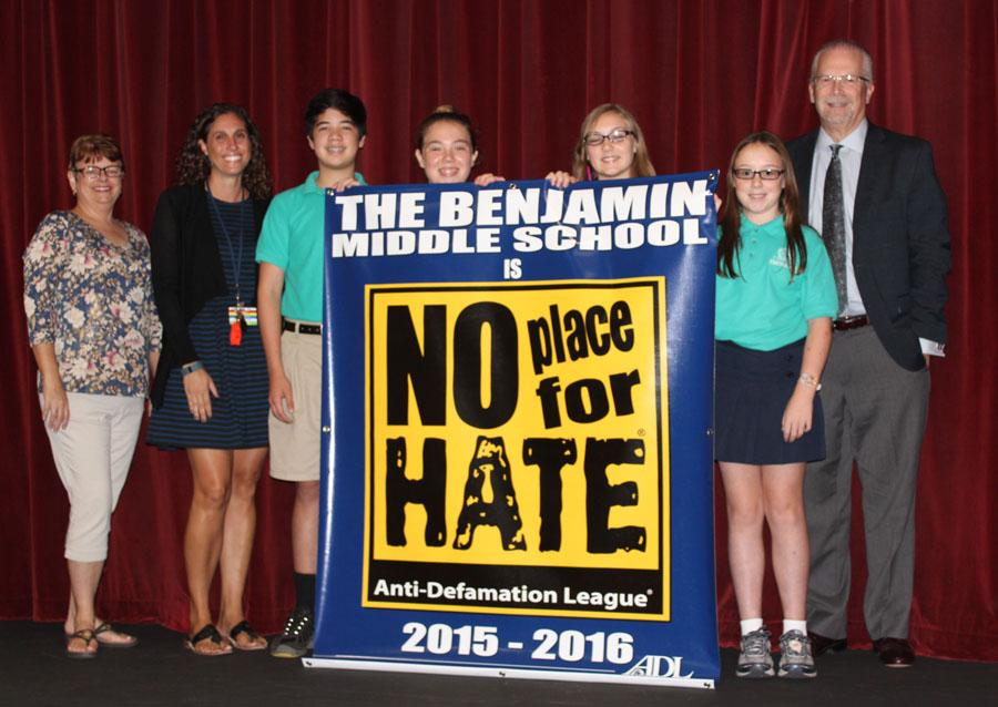 Left to right: Science Department Chair Ms. Gabriele St. Martin, Student Services Coordinator Ms. Danielle Benvenuto, Student Council President Nicolas Lama, Student Council members Demi den Bakker, Briley Crisafi, and Olivia Beam, and Head of School Mr. Robert Goldberg display the banner from the ADL.