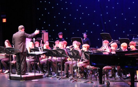 Mr. Huber conducts the middle school bands during the concert.