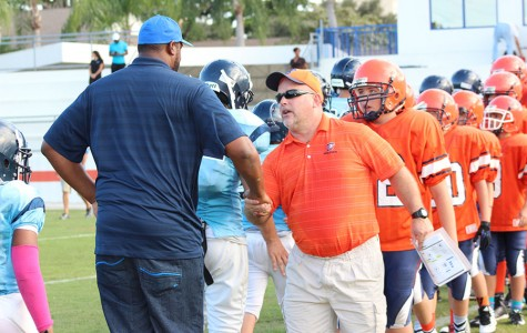 Seventh and eighth-grade football coach Mr. Greg Keller shakes hands with the head coach for Coral Springs Charter after their game on October 7.