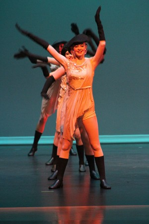 "Eighth grader Katie Abrams leads her line of dancers during the show's ""French Medley."""