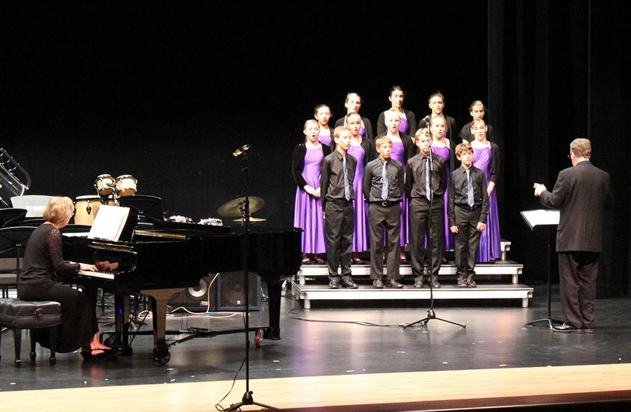 Mr.++Winters+conducts+the+Middle+School+Chorus+while+Ms.+Gay+Dedo++accomapanies+on+the+piano.
