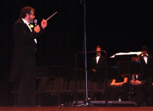 Dr. Nagy gestures to the Upper School Band while addressing the audience during the festival.