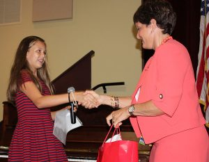 Treasurer Emeline Smith accepts a gift from Mrs. Corey after making her speech on September 19. All of the candidates received a small congratulatory gift from Corey for running for office.