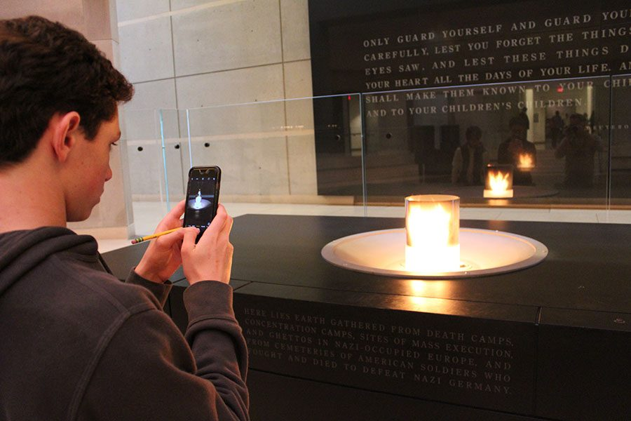 Eighth+grader+Chase+Shapiro+takes+a+photo+of+the+candle++that+rests+upon+a+crypt+of+earth+taken+from+Nazi+concentration+camps+in+the+Holocaust+Memorial+and+Museum.