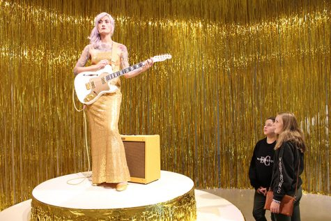 """Eighth graders Julia Kirschenbaum and Kate Lower consider """"Woman in E,"""" an example of performance art by Icelandic artist Ragnar Kjartansson in the Hirshhorn Museum."""