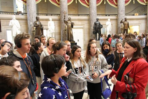 THe students listen to a docent explain the statues beneath the rotunda in the Capitol Building.