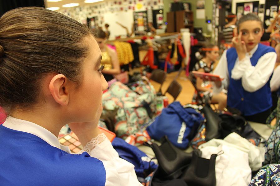 Eighth grader Chloe Habib gets ready backstage for the