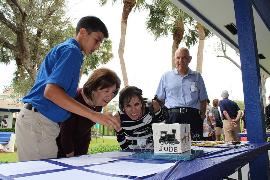 EIghth grader Aidan Neidoff explains his monument project to his grandparents: (left to right)  Ms. Rochelle Hollander, Mrs. SHoshanna Neidoff, and Mr. Barry Neidoff.