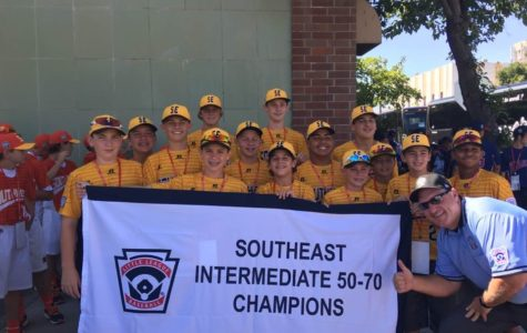 Jack Savery (third row, second from left) and his teammates display their southeast champions banner during the opening ceremonies of the Intermediate Division Little LEague World Series in Livermore, California.