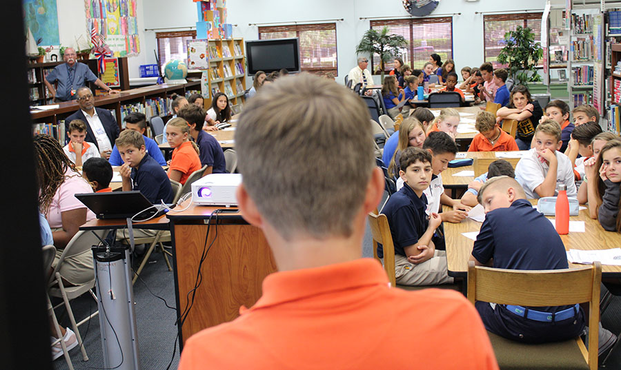 Seventh grader William Harris makes his groups presentation in the library/media center based upon a worksheet the students completed during the ADL training.