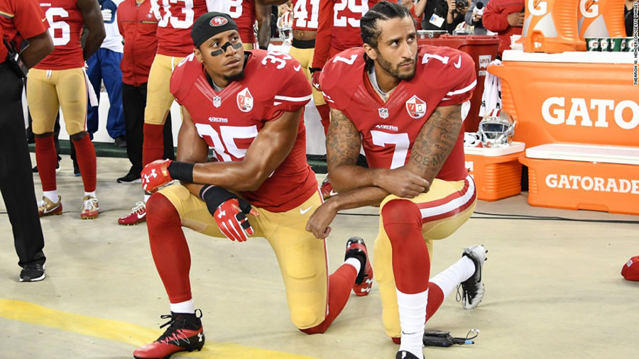 Colin+Kaepernick+%28right%29+and+Eric+Reid+kneel+during+the+national+anthem+prior+to+a+game+in+Santa+Clara%2C+California+on+September+12%2C+2016.