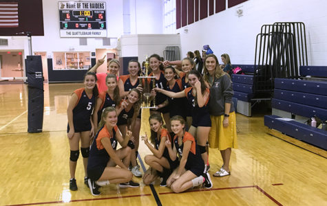 The Bucs pose with their hard-earned trophy after beating St. Mark's at Rosarian Academy on October 12, 2017.