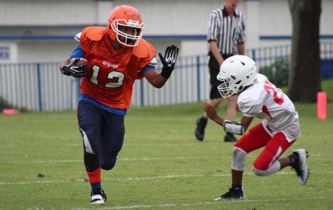 Brandon Powell  looks to stiff arm a defender during the Bucs' 28-14 win over Westminster Academy on October 4.