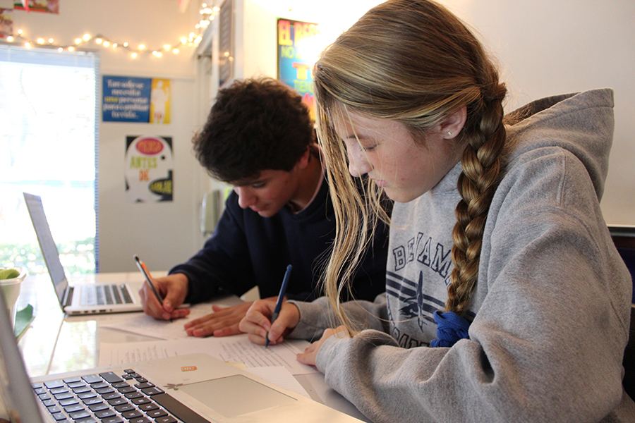 Eighth graders Ryan Casey (left) and Kate Small get started on their assignments during Mr. Maddox's study hall period on Tuesday, October 26, 2017.