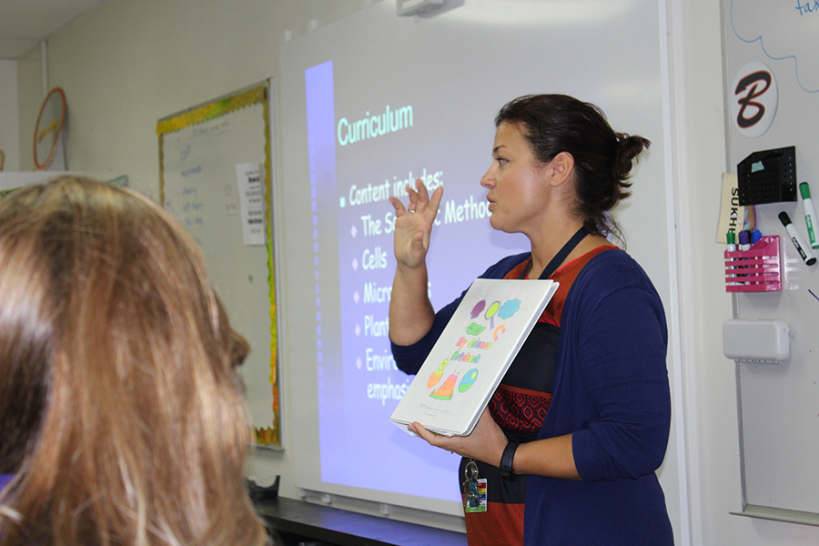Sixth-grade science teacher Mrs. Mandy Sukhu talks to parents about her science curriculum.