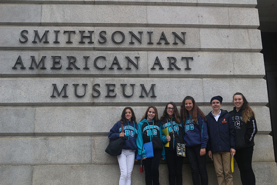 Eighth graders Amelia Porges, Catherine Schenk, Kiley Malmberg, Ella Pierman, Jakob Kroll, and Demi den Bakker pose in front of the Smithsonian American Art Museum on Wednesday, November 8.