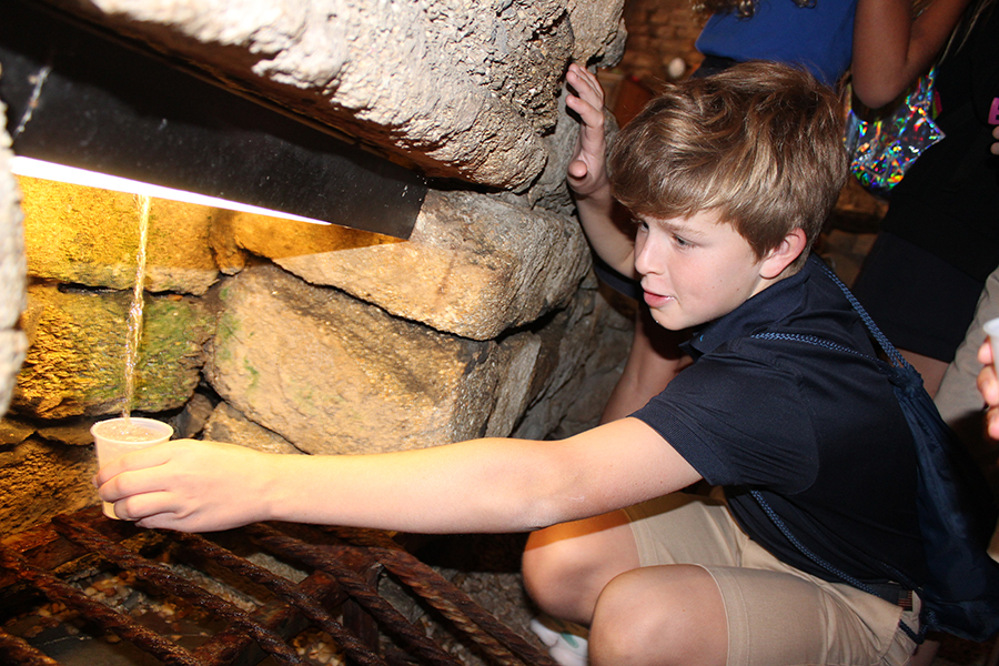 Sixth grader WIlson Stewart collects some drinking water from the Fountain of Youth during the grade's first stop in St. Augustine.