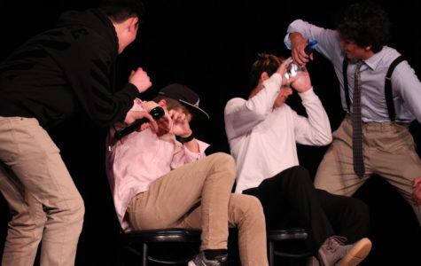 Eighth graders Jacob Steinger (left) and Ryan Casey portray the play's two detectives as they question the bus driver, Moe Petty (Casey Crawford) and teacher Joe McGuffey (Cameron Salehi).