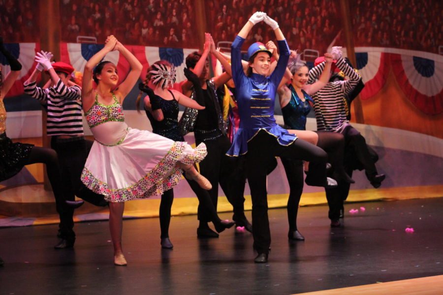 Eighth+grader+Madi+McVey+%28center%29+leads+Mrs.+Rudner%27s+dance+classes+in+their+%22Circus%22+number+in+Act+II.