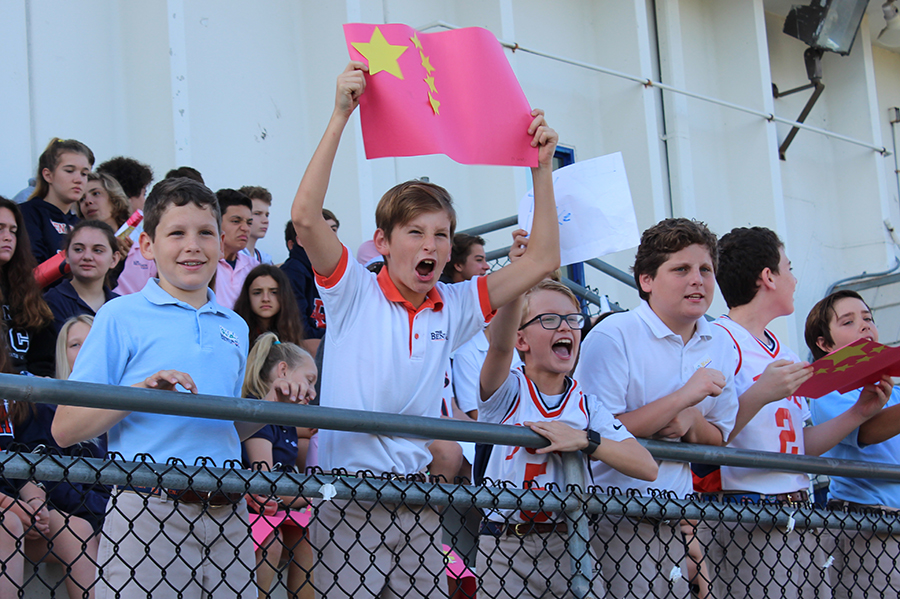 Sixth graders Arthur Wolff, J.P. Jacobs, Sam Storch, and Tim Mahon cheer for China and the other participants  in the Lower School Olympics.