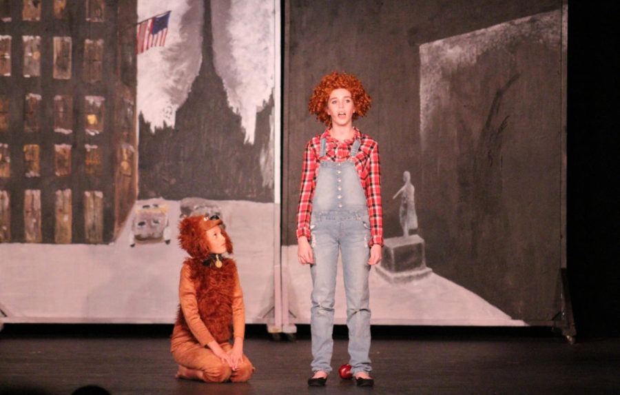 Annie, played by eighth grader Catherine Schenk, sings on the BPAC stage with her dog, Sandy (sixth grader Maggie Smith).