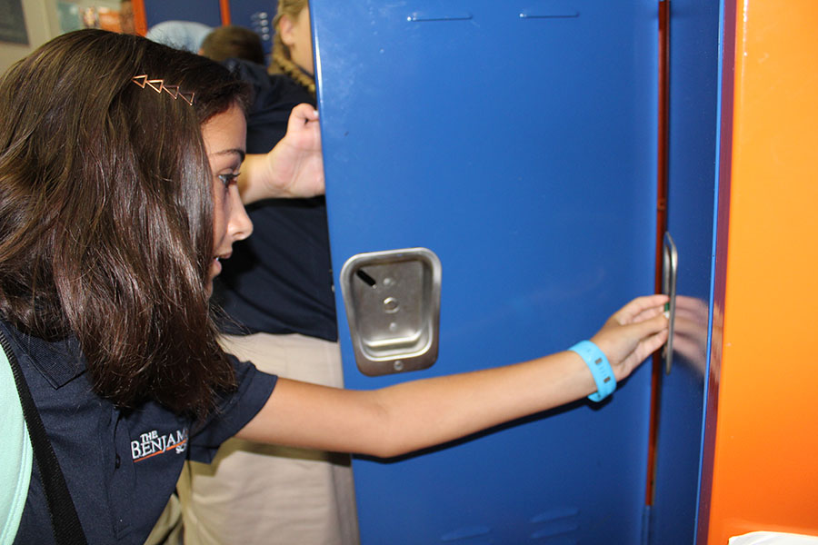 Sixth grader Athena Lekkas gets used to opening her locker on the first day of school. Lekkas enjoys sixth grade thus far, especially having the opportunity to play volleyball.
