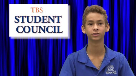 TBS News anchor Eric Levine delivers news about a students council meeting during the broadcast.
