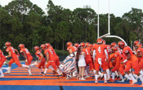The Bucs' varsity football team run out onto the field prior to their Homecoming Game against John Carroll on October 5, 2018.