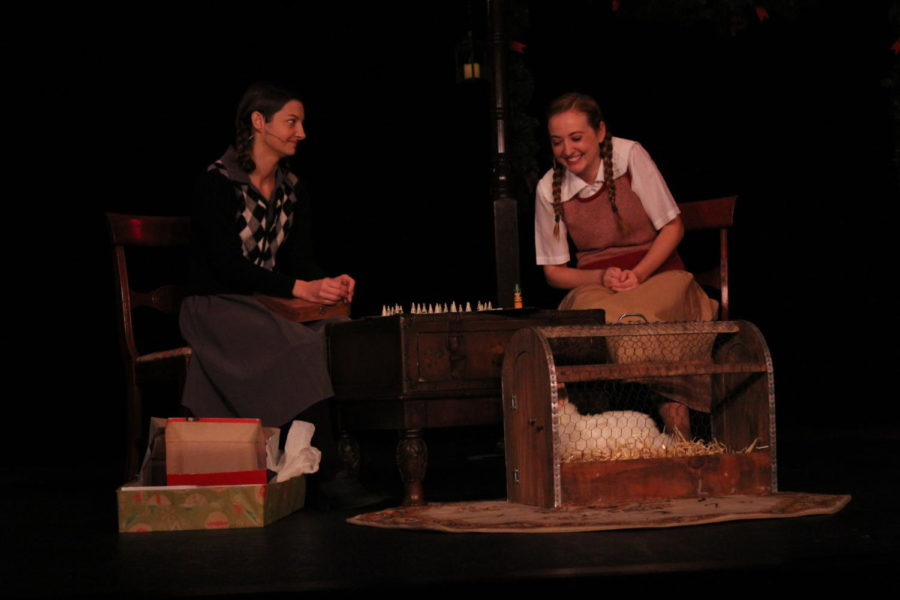 The character of Elfie Hoffman (left) reluctantly plays the anti-Semitic game her friend and neighbor brought over during the presentation of