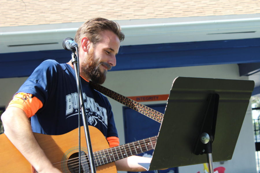 Humanities teacher Mr. Nathan Ginnetty performs an acoustic version of Michael Jacksons Thriller in the Quad during Buc-O-Ween.