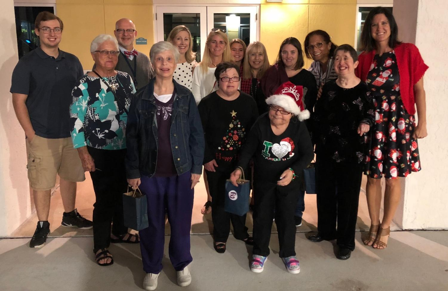 TBS students and faculty help out members of the Palm Beach Habilitation Center on Friday, December 7.