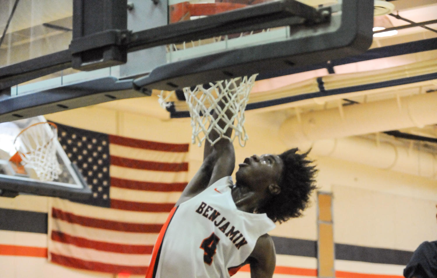 Eighth grader Marvel Allen soars to the rim during a game against Yeshiva on December 11, 2018. The Bucs won 59-27.