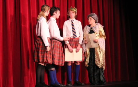 (Left to right), seventh grader Natalie Cona, eighth graders Alex Bories and Colby German, and seventh grader Arthur Wolff of the Swedish side discuss their plans to get Shakespeare to tell them the story of MacBeth.