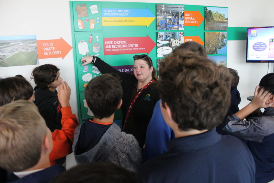 One of the Solid Waste Authority's employees informs students about the company's different facilities and how they help the environment.