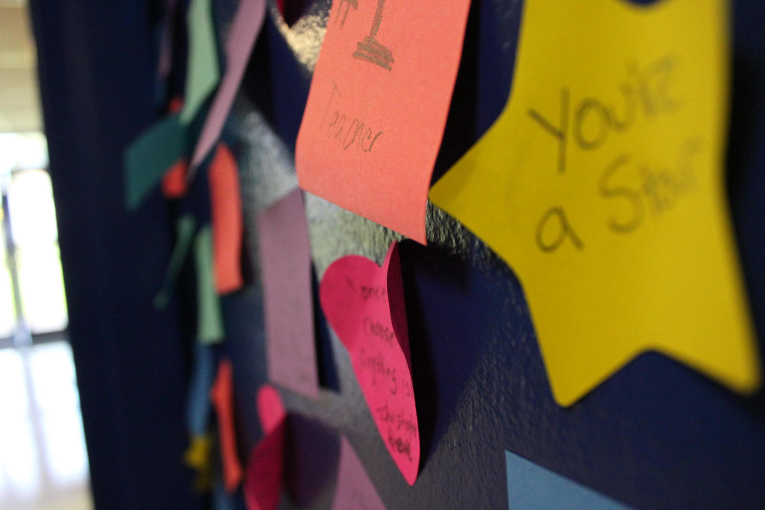 Positive notes made by students adorn Mr. Crisafi's classroom door after his brother-in-law passed away earlier this year.