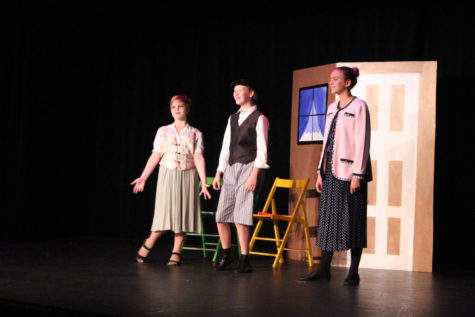 "The Paroo Family, portrayed by Sarah Darby, Natalie Cona, and Samantha Treadwell, share the stage during the ""Gary, Indiana"" number."