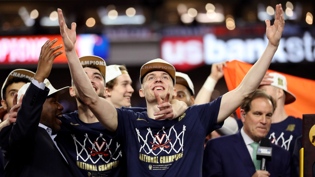 Virginia players celebrate their first NCAA men's basketball national title.