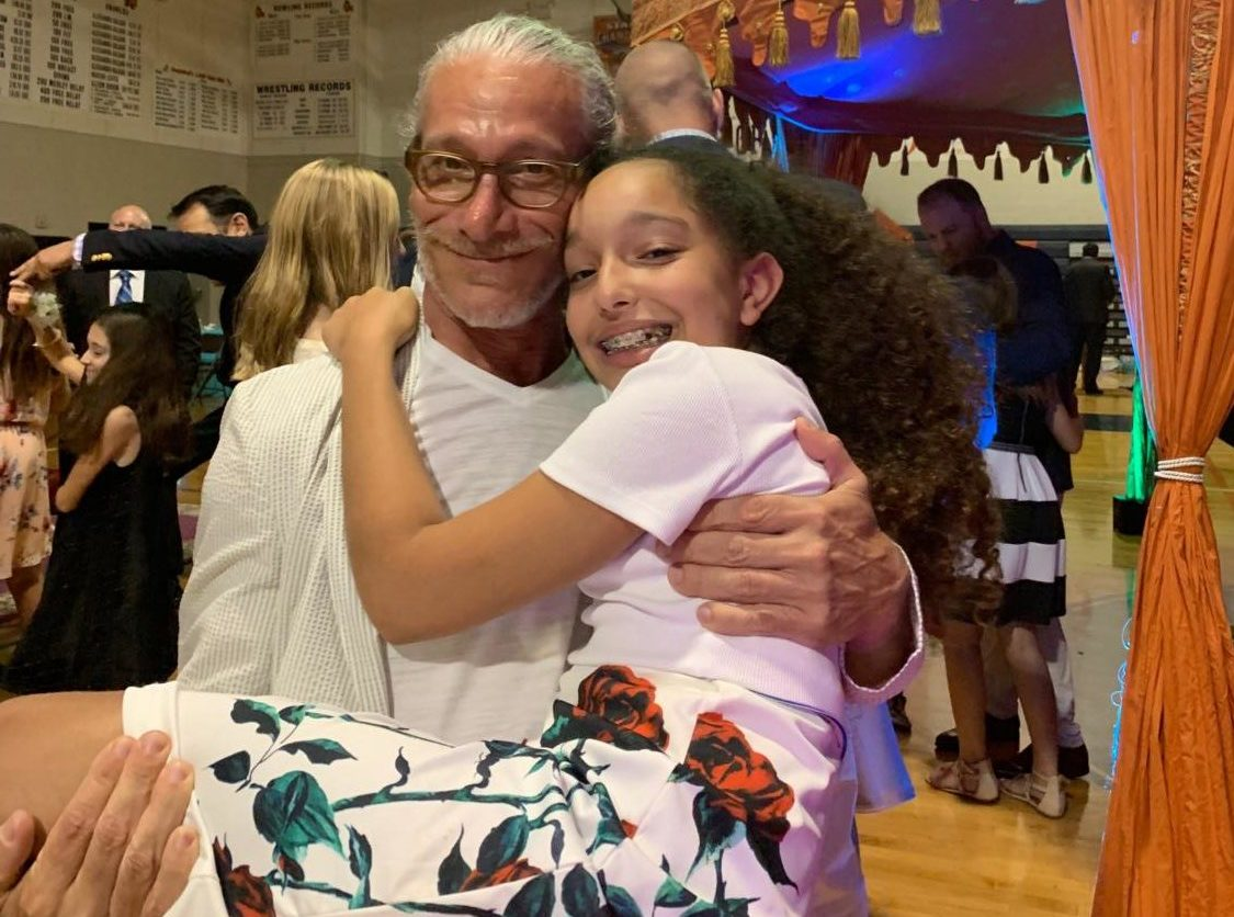 Mr. Gary Gelman poses with his seventh-grade daughter, Joix, at the dance.
