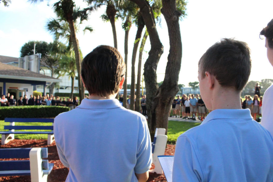 Eighth graders Atticus Fasnakis-Nosal and Keane Adam listen to the kind words spoken at the 9/11 ceremony.