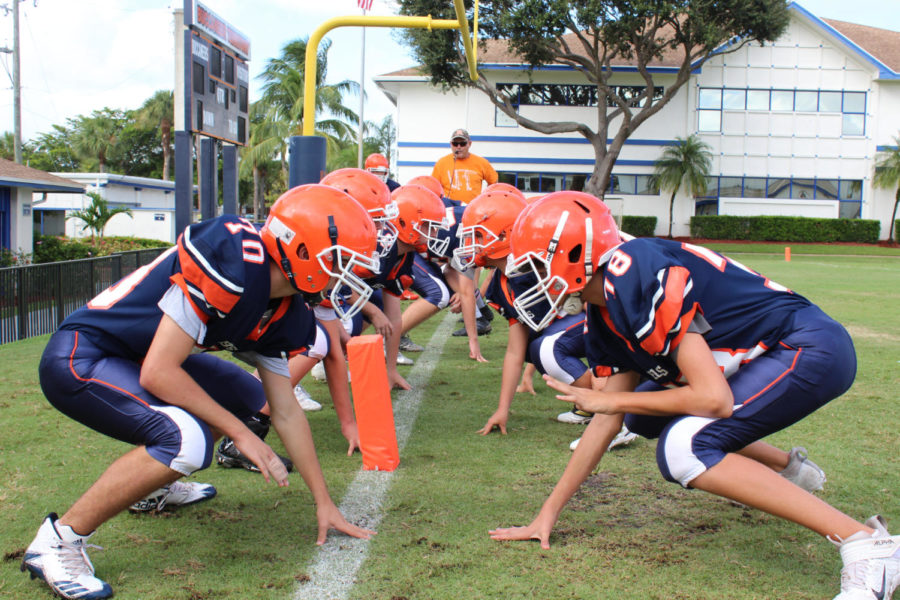 The middle school football team warms up before a game.