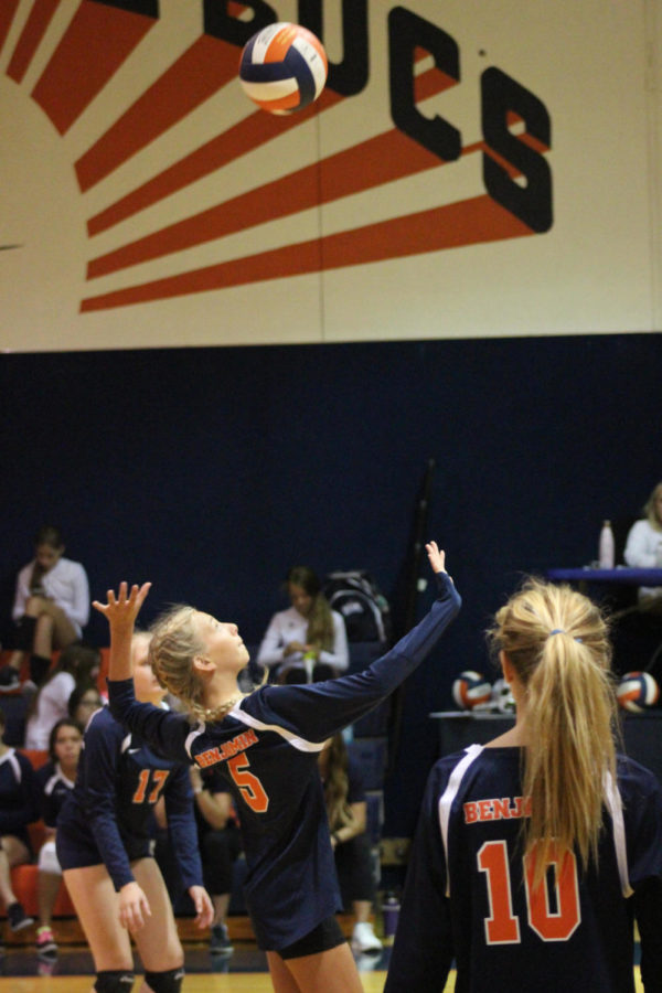 The volleyball team practices for their game on October 1st.